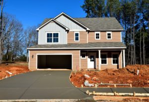 how to landscape your driveway - here is a house being built without any landscaping completed